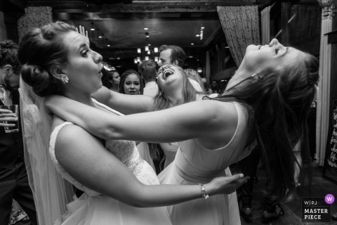 Bride dances with maid of honor at the wedding reception in Tahoma, California