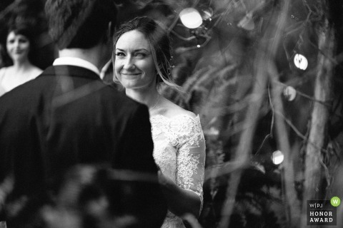 Minneapolis, MN wedding photographer - all smiles for this bride during her outdoor ceremony captured in black-and-white