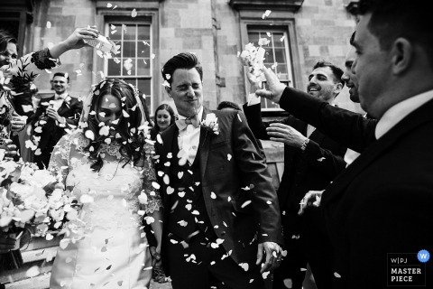 England guests celebrate with the bride and groom after getting married