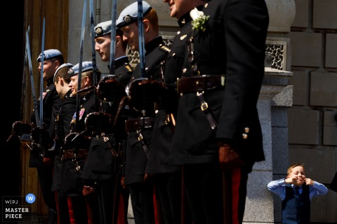 Devon boy making faces behind soldiers at the wedding