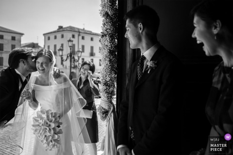 Brides father kisses her on the cheek at the wedding in Veneto, Italy