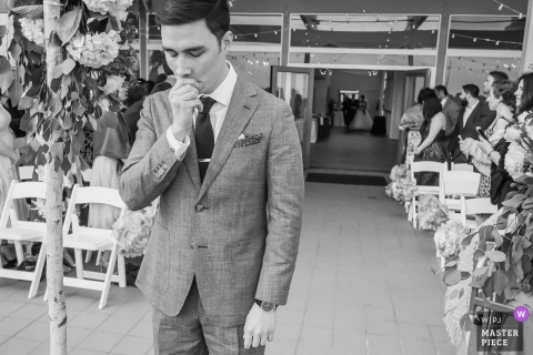 Groom waiting for the bride and her father at the wedding ceremony in Malibu, California