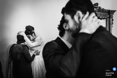 Bride and groom hugging guests after the wedding ceremony in Paris, France