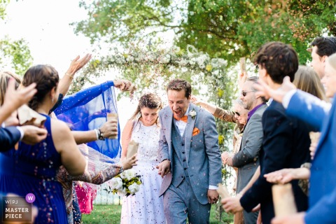 Titignano, Umbria outdoor wedding ceremony - the Gauntlet of guests for the bride and groom