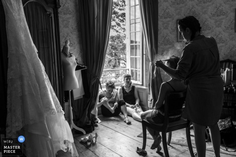 Hair spray and make up time for the bride getting ready for her wedding in Leoville