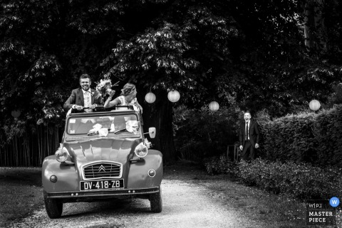 Leoville wedding reception arrival of the bride and groom in an open top car