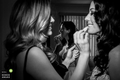 Montreal, Quebec wedding photographer - the bride gets help with her lipstick from a friend