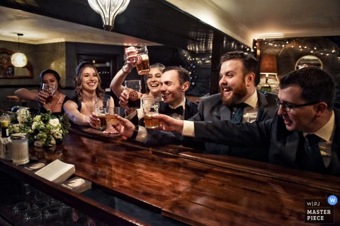It's all cheers and beers for the bridal party at the bar in this photo from a wedding reception in Montreal, Quebec