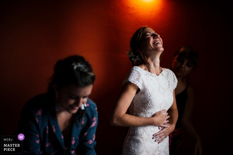 Photo of bride laughs at the wedding reception in Villa Le Cascine, Montaione, Italy.