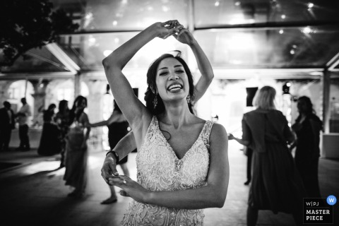 Portugal wedding reception Photo in black-and-white of dancing guests spinning