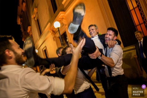 Cosenza wedding reception party Photo of the guys having fun
