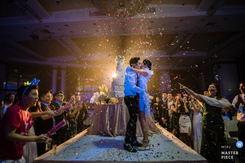 Colorful confetti flies in the air during this Bangkok wedding reception