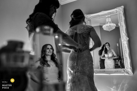 The brides reflection is captured in this black-and-white photo as she is getting ready in Temecula, California
