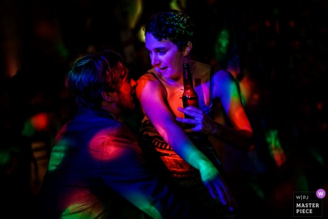 Reception dance party revelers enjoy the colorful spotted lights at this Temecula, California wedding