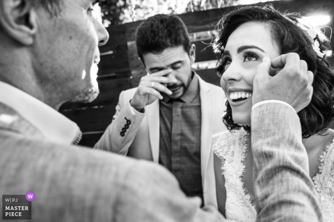 A tearful moment it Is captured in this black-and-white photo of the bride getting help wiping tears in Rio de Janeiro