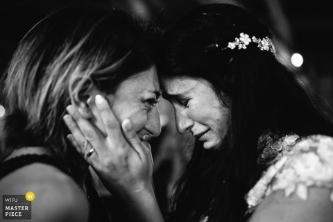 Black-and-white photo. Face to face emotion.