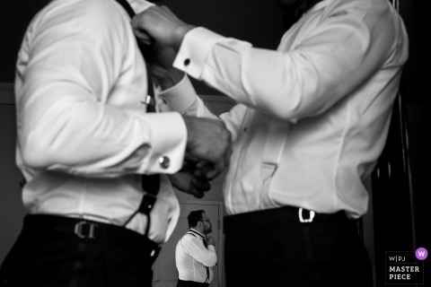 The groom and best man get dressed before this Las Vegas wedding