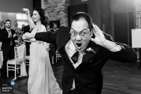Auberge des Gallant, Saint-Marthe, Quebec Black and white wedding photo of the groom encouraging the guests to get louder