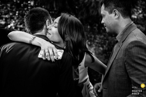 Tuscany outdoor wedding reception Photo of a warm hug