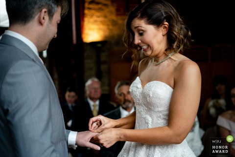 Bride and groom during their vows at Bartholomew Barns | East Sussex wedding photographer