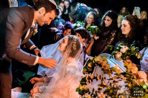 Israel groom smiles as he sees the bride during the ceremony - Jerusalem wedding photography