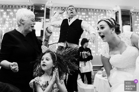 Black-and-white photo of celebration time at this wedding reception in Cheshire, England