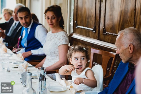 Netherlands girl enjoying the food at the reception