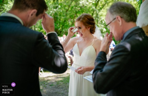 Canada bride and groom get emotional during the wedding ceremony outside