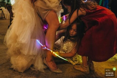 Kids put glow sticks on the bride at this Los Angeles wedding reception