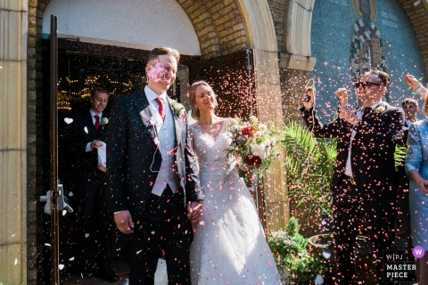 Picture of guests celebrating with the bride and groom after the ceremony at the Serbian Orthodox Church, London UK