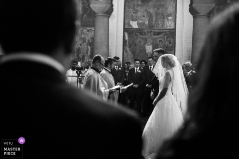 Photo of bride and groom during the wedding ceremony at the Serbian Orthodox Church, London UK