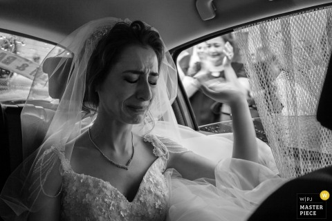Tekirdag, Turkey bride gets emotional as she waves goodbye to guests after the wedding ceremony