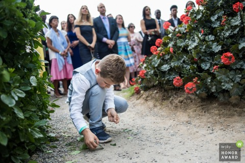New Jersey boy plays in the dirt during the ceremony