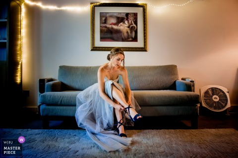 Bride getting on her shoes before the wedding ceremony in Waitsfield, Vermont