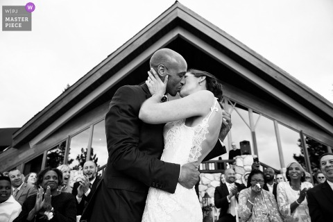 Bride and groom kiss at the wedding ceremony outside at Lake Tahoe, NV