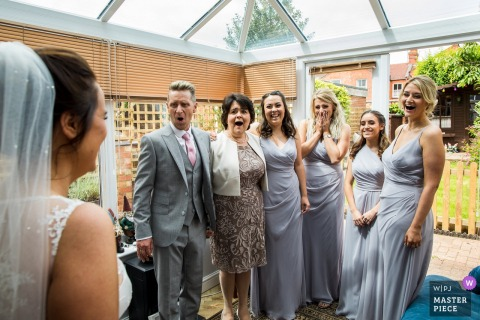 Bridal party is stunned when they see the bride in her wedding dress in Northamptonshire, United Kingdom