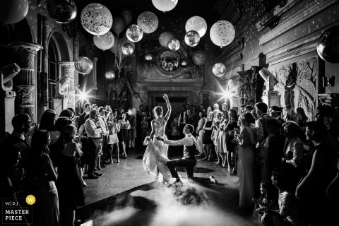 Bride and groom dance with each other at the wedding reception at Aynhoe Park, United Kingdom