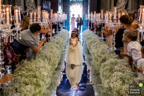Basilica di San Martino ai Monti - Rome - flower girls walking in to the wedding ceremony on a reflective floor
