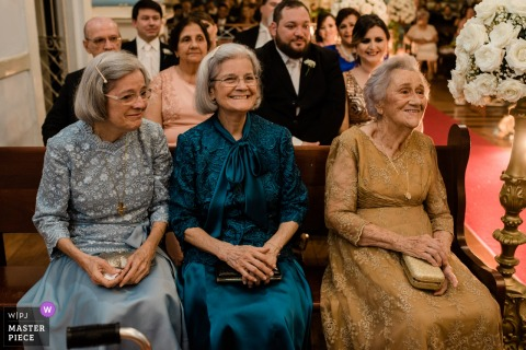Guests smile during the wedding ceremony in Rio de Janeiro
