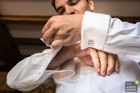 Sainte Marie de Gosse, France - Group getting ready with his cufflinks before the ceremony