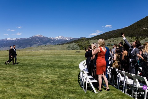 Outdoor photo of guests taking photos during the wedding ceremony in Pray, Montana