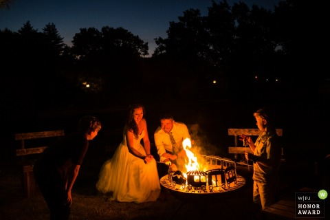 Bride and groom at an open pit fire -  Roaring Camp Felton, CA