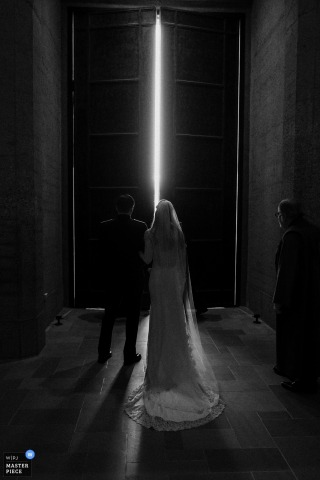 Bride and groom hold arms and wait for the door to open in San Francisco
