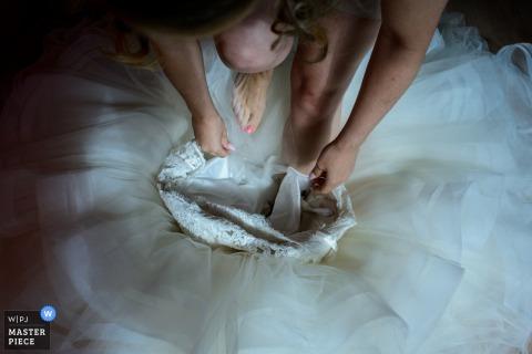Bride getting her dress on before the wedding in Beveren