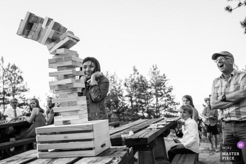 Jenga-Zusammenbruch bei Boulder, Hochzeitsempfang im Freien Colorados - Sonnenaufgang-Amphitheater, Boulder, Colorado