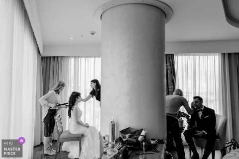 Photo of the bride and groom getting help getting ready before the wedding ceremony in Turkey, Bursa