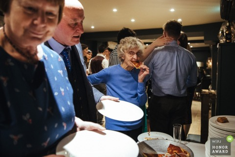 The George in Rye, UK - wedding guests size up the food options at the reception buffet bar