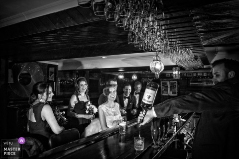 Bridal party enjoying drinks at a bar after the wedding ceremony in Montreal, Quebec