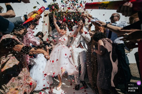 Portugal guests congratulate the bride and groom with confetti after the wedding ceremony