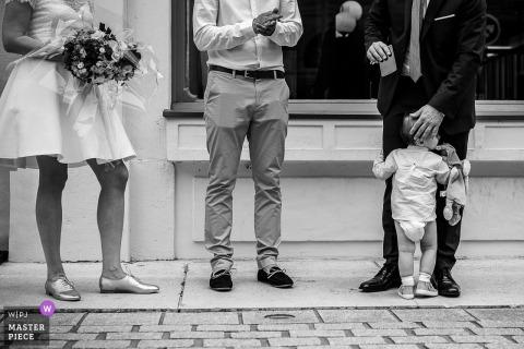 Savoie groom holds little boy during the wedding
